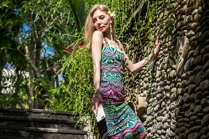Beautiful slender woman among tropical plants. Beauty, fashion. Spa, healthcare. Tropical vacation. Bali island.
