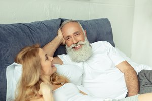 mature couple relaxing on bed