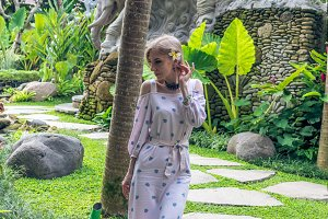 Woman walking in a tropical garden of Bali island, Indonesia.
