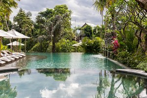 Luxury swimming pool at villa of tropical Bali island, Indonesia.