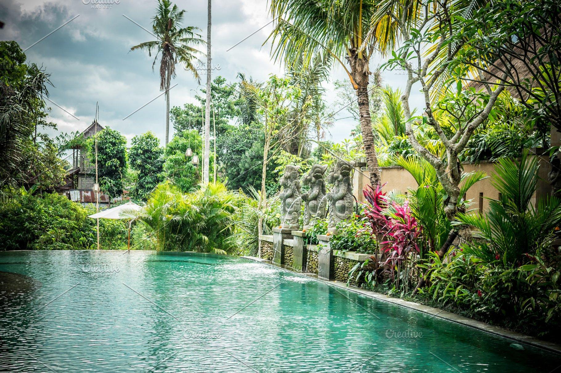 Luxury swimming pool at villa of tropical Bali island, Indonesia.