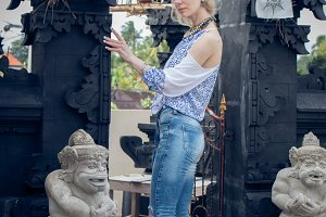 European young lady at balinese traditional temple. Bali island, Indonesia.