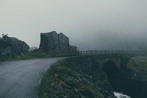 Bridge over a foggy River