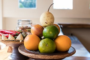 Basket of mandarins on a wooden table. Bali island.