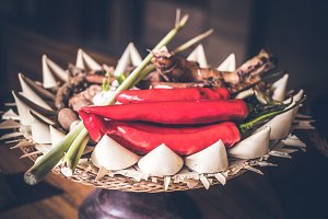Red Chili peppers in a traditional balinese small basket. Bali island.