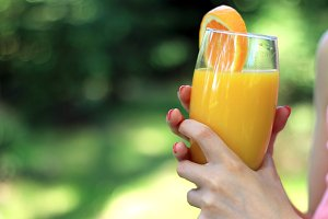 Summer orange juice in hand