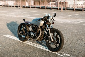 Cafe racer motorcycle on parking.