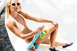 Beautiful fit girl with skateboard.