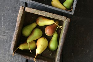 Fall pears on wooden table