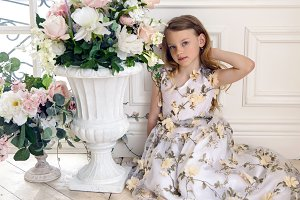 girl in floral dress sitting on the floor