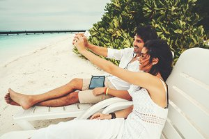 Couple on the beach making selfie
