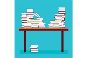 Pile of Books on a Wooden Table.