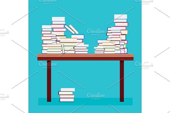 Pile Of Books On A Wooden Table