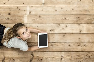 Young girl with tablet mockup header
