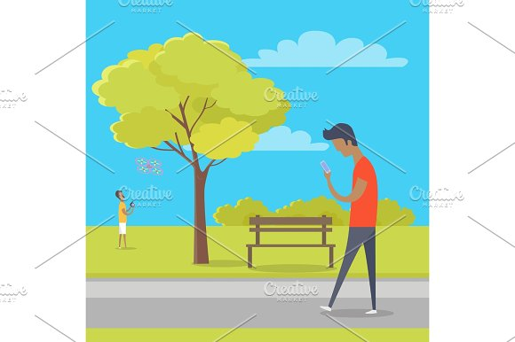 Boy With Smartphone On Walk In Park Out Of Town