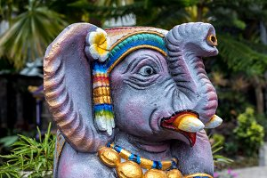 Colorful stone elephant statue on a tropical Bali island, Indonesia.
