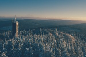 Look-out Tower over a Winter Forest