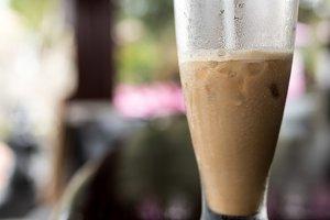 Iced coffee or caffe latte close up in pool bar. Bali island, Indonesia.