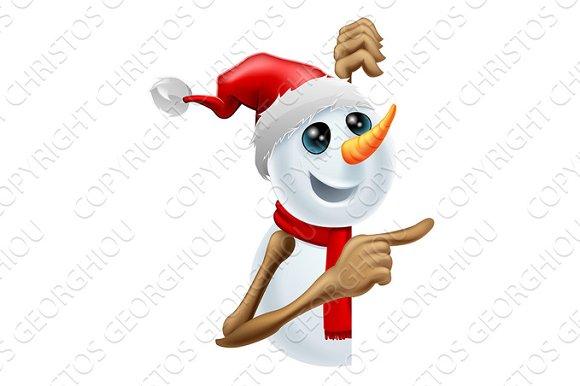 Happy Snowman In Santa Hat Pointing