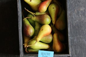 Healthy food concept. Pears in wooden box on table