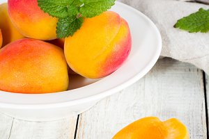 apricots on white plate
