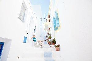 Beautiful girl on old greek street