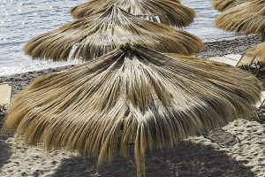 Straw umbrellas on the beach