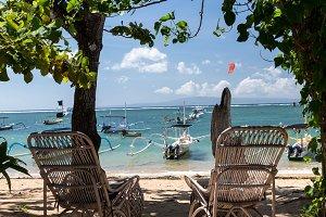 Couple wooden chair near the beach, tropical Bali island, Indonesia.