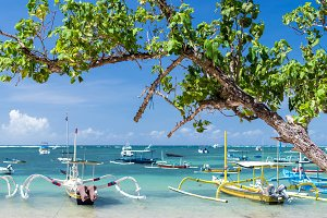 Fishing boats in the Indian ocean, tropical island Bali, Indonesia. Sanur beach.