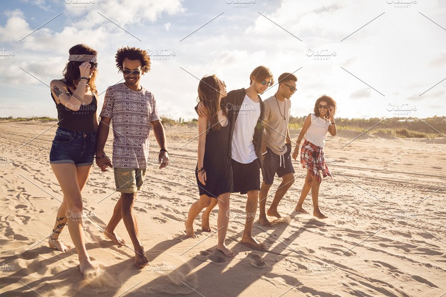 multiethnic group of friends walking on the beach people images