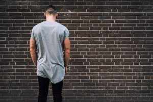 Hipster man on a brick background