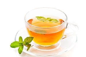 Tea cup with mint isolated