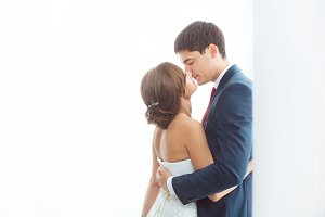 Bride and groom in very bright room at home