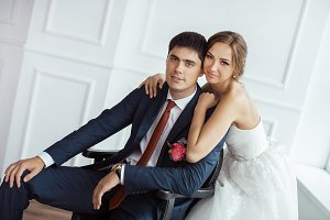 Bride and groom in very bright room
