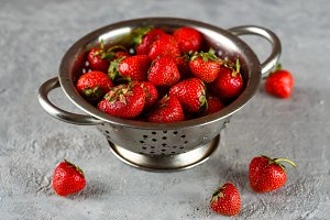 Ripe strawberry in colander
