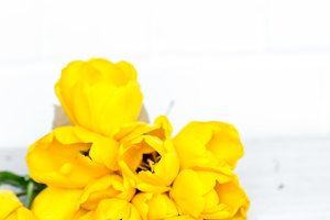 postcard Mother's Day and yellow tulips on wooden background