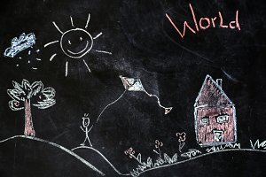 chalk drawing of house and sun on a black background,