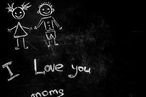 drawing with chalk on a black background for a mother