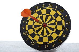 red dart In a dartboard on white