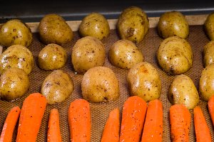 Potatoes and carrots on a baking sheet