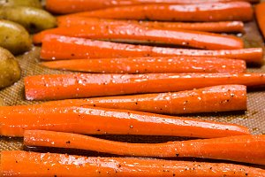 Fresh orange carrots on a baking sheet