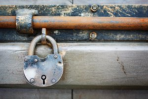 Old rusty aged padlock