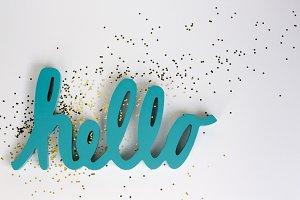 Teal Hello + Gold Sparkles Flatlay