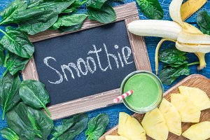 Detox green smoothie with spinach, pineapple, banana and yogurt, horizontal, top view