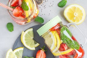 Healthy detox chia seed drink with strawberry, lemon and mint in glass jar, vertical, top view