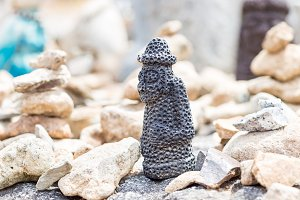 Small stone figure of hareubang Jeju island idol, shot in prayer place of buddist temple South Korea