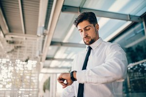 Business executive checking time
