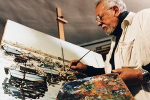 Artist painting oils in his studio.
