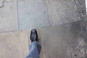 man walking on pavement