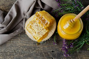 Honeycombs and glass pot with honey